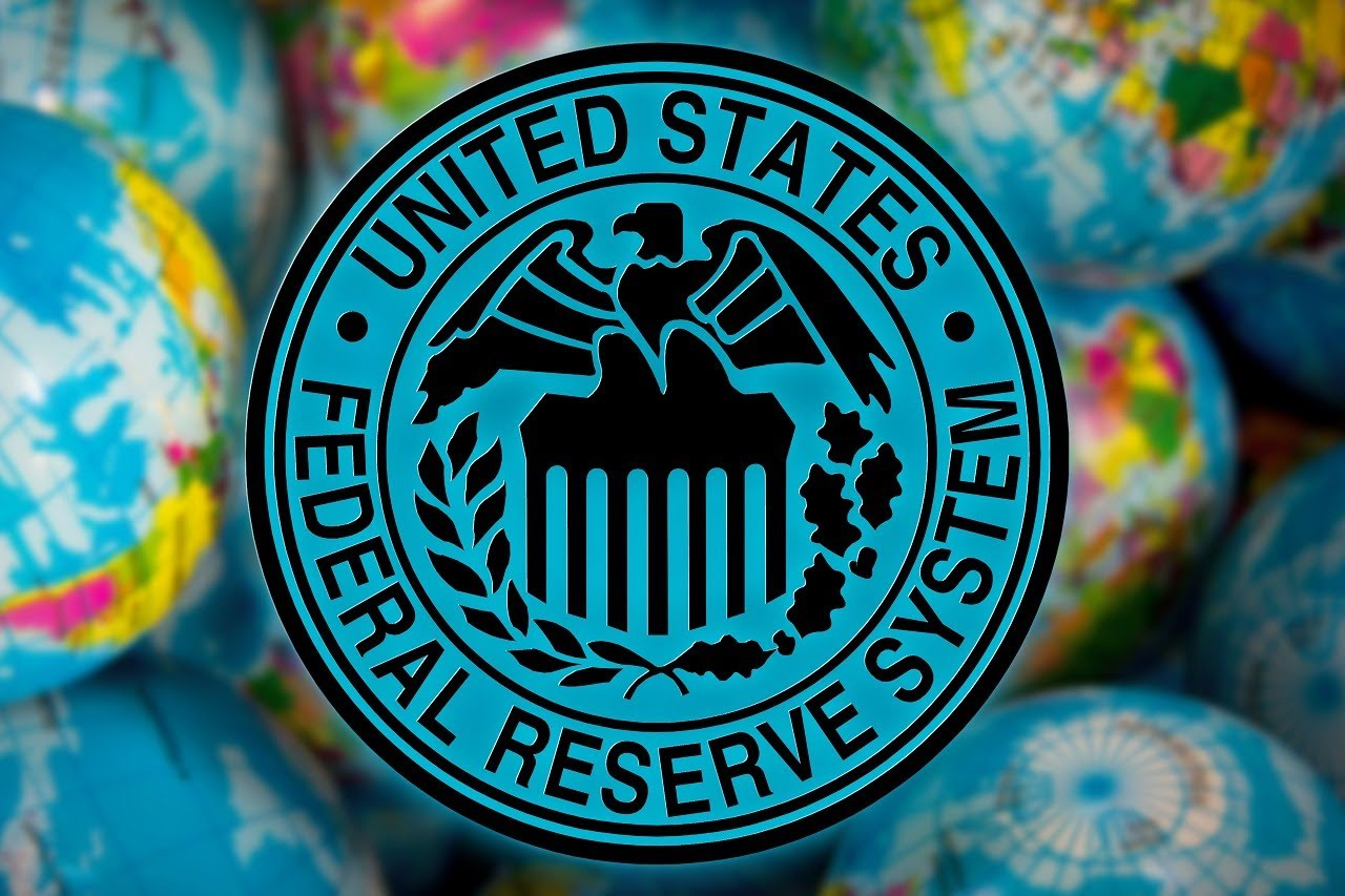 United States Federal Reserve System symbol (FED) on the globe background, business and financial concept